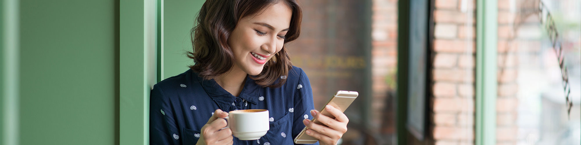 smiling woman looking a smartphone
